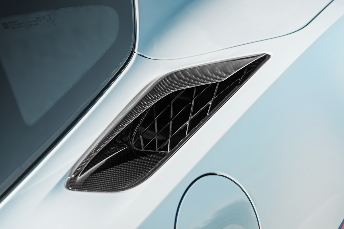 Carbon 65 Edition coupes feature new carbon-fiber quarter intake ducts.